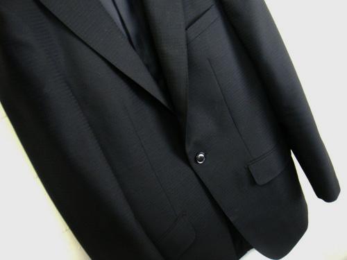 1つボタンのスーツ