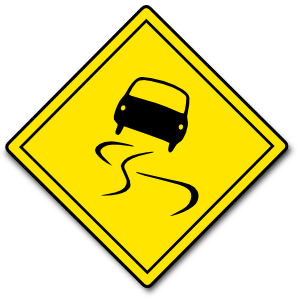 スリップ注意の道路標識のイラスト